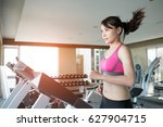 woman run on treadmill in the... | Shutterstock . vector #627904715