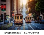 Small photo of Classic view of historic traditional Cable Cars riding on famous California Street in morning light at sunrise with retro vintage style cross processing filter effect, San Francisco, California, USA