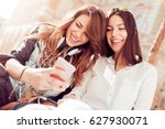 two young beautiful girls are... | Shutterstock . vector #627930071