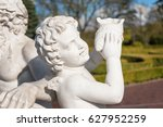 Statue Of Cupid With Shell In...