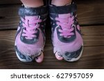 old worn out shoes with holes... | Shutterstock . vector #627957059