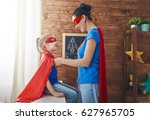 mother and her child playing... | Shutterstock . vector #627965705