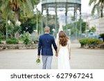 bride and groom walking holding ... | Shutterstock . vector #627967241