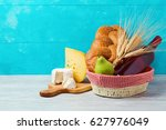 basket with wine bottle  bread... | Shutterstock . vector #627976049