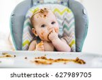 a little baby eating her dinner ... | Shutterstock . vector #627989705