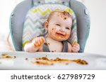 a little baby eating her dinner ... | Shutterstock . vector #627989729
