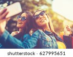 two attractive women taking... | Shutterstock . vector #627995651
