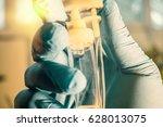 doctor's gloved hand... | Shutterstock . vector #628013075