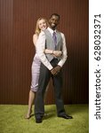 well dressed couple hugging | Shutterstock . vector #628032371