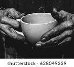 senior man holding cup of tea...   Shutterstock . vector #628049339