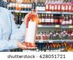 woman buys wine in shop | Shutterstock . vector #628051721