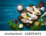 raw chicken legs with herbs and ... | Shutterstock . vector #628054691