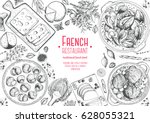 french cuisine top view frame.... | Shutterstock .eps vector #628055321