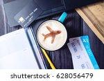 laptop  plane tickets  coffee ...   Shutterstock . vector #628056479