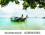 long tail boat on tropical...   Shutterstock . vector #628064381