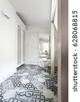 Small photo of White attic apartment interior with shabby chic furniture