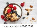 bowl of oat granola with yogurt ... | Shutterstock . vector #628082831