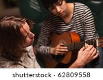 young male musician teaches... | Shutterstock . vector #62809558