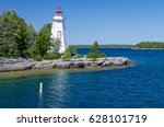 lighthouse on great lakes | Shutterstock . vector #628101719
