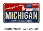 greetings from michigan vintage ... | Shutterstock .eps vector #628123889