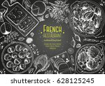 french cuisine top view frame.... | Shutterstock .eps vector #628125245
