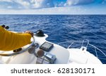 hand of captain on steering... | Shutterstock . vector #628130171