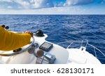 hand of captain on steering... | Shutterstock . vector #628130171