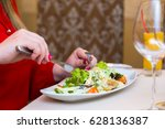 woman in red eats salad natural.... | Shutterstock . vector #628136387