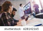 happy creative coworkers...   Shutterstock . vector #628142165