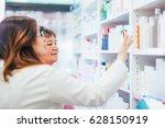 pharmacist and senior costumer... | Shutterstock . vector #628150919
