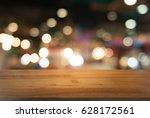 empty wooden table in front of...   Shutterstock . vector #628172561