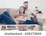 cheerful couple is watching tv... | Shutterstock . vector #628173044