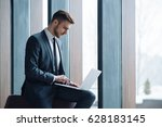 young handsome man working in... | Shutterstock . vector #628183145
