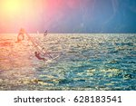 windsurfer surfing the wind on... | Shutterstock . vector #628183541