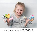 lovely small girl with doll...   Shutterstock . vector #628254311