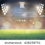 stadium in lights and flashes... | Shutterstock . vector #628258751