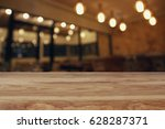 image of wooden table in front... | Shutterstock . vector #628287371