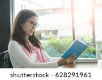 happy young woman reading a... | Shutterstock . vector #628291961