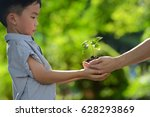 two hands holding together a... | Shutterstock . vector #628293869