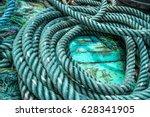 marine rope on wooden background | Shutterstock . vector #628341905