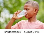 thristy african boy drinks... | Shutterstock . vector #628352441