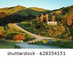 new zealand rural road  house ... | Shutterstock . vector #628354151