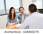 happy young couple in office... | Shutterstock . vector #628360274