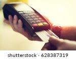 man making credit card payment | Shutterstock . vector #628387319