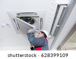 specialist cleans and repairs... | Shutterstock . vector #628399109