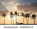 sunset palm beach with people's ... | Shutterstock . vector #628404515