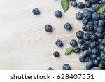 freshly picked blueberries... | Shutterstock . vector #628407551