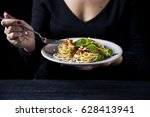 a woman is eating a fork with... | Shutterstock . vector #628413941