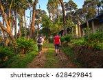 tourists walk on the wild... | Shutterstock . vector #628429841