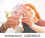young loving couple with small... | Shutterstock . vector #628430621